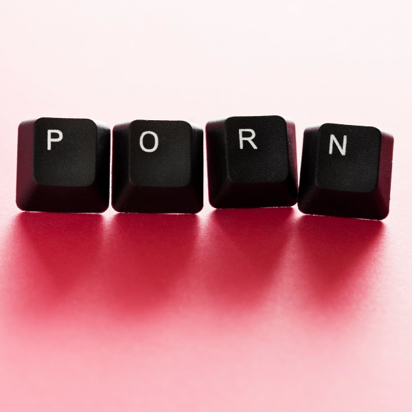 Image of keyboard tiles spelling out 'porn' on pink background